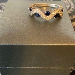 Blue and diamond Helzburg ring.